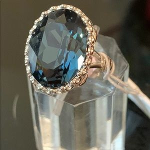 Blue sapphire ring surrounded by Diamonique